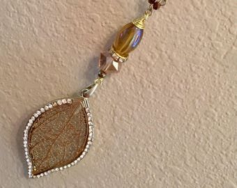 Gold leaf pendant with bead accents and beaded chain