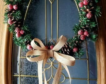 Simple berry and pinecone wreath, with glitter burlap bow.
