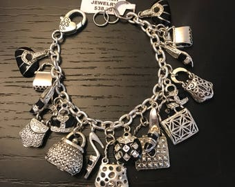 One of a kind charm bracelet featuring shoes and purses