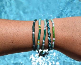 Assorted Green String Bracelets