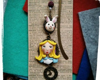 Bookmark Alicia in the country of wonders. With miniature rabbit.