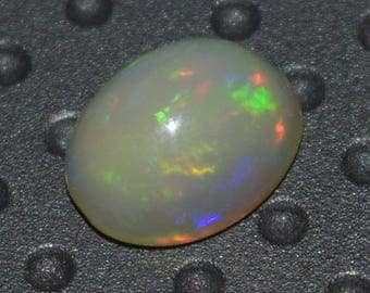 1.25 Carat Oval Shape Natural Ethiopian Welo Multi Fire Opal Cabochon Gemstone Ethiopian Opal 7x9 mm On Wholesale Price B014
