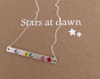 Delicate sterling silver bar necklace embellished with rainbow coloured Swarovski crystals
