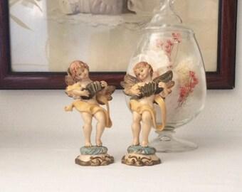 Pair of figures of angels hand painted plastic. Vintage