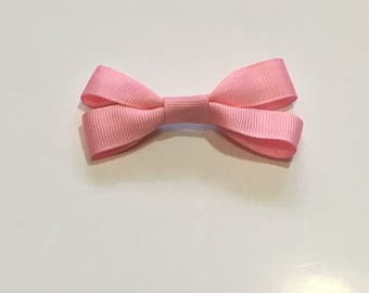 Bubblegum pink hair bow accessory with alligator clip