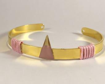 Bangle is flat geometric gold pink