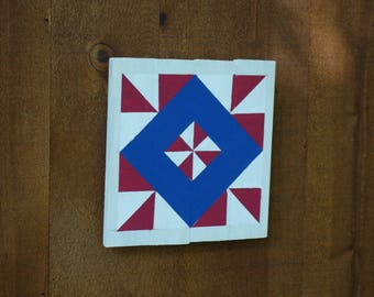 Barn quilt sign in red, white, and blue. Barn quilt pattern on reclaimed wood. Barn quilt design.