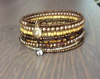 Brown and gold tone beaded wrap bracelet