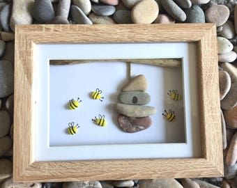 Pebble art - bees and hive