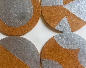 Four cork placemats and/or cork coasters with hand painted modern geometric design in silver