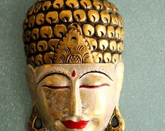 hand carved wooden buddha mask wall art made in Bali