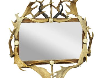 antique antler frame with rustic antler decorations and mirror