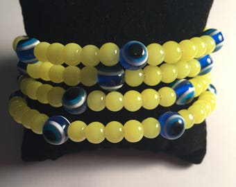 Yellow beaded with Nazar beads memory wire bracelet
