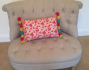 Poppy pom pom cushion