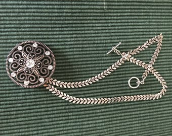 Antiqued silver filigree medallion on silver fishtail chain necklace