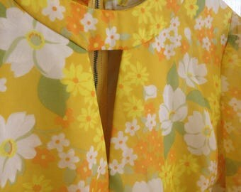 Yellow with orange white and green floral pattern keyhole neckline long sheer sleeve zipper