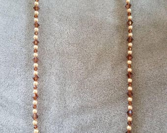 19.25 inch Swarovski crystal and Swarovski pearl necklace in shades of brown and tan.