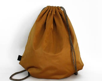 Gold  waterproof drawstring bag backpack with lining and zipper pocket Unique