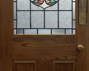 Fully restored Art Nouveau stained glass fitted into a new solid pitch pine door