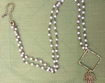 Long cool, brass and pearl necklace with Hamsa Hand pendant