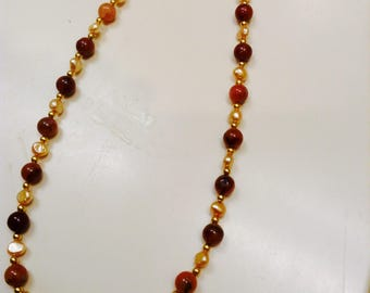 Necklace:     Fresh Water Pearls with Rust Glass beads