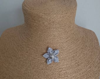 Gray fabric Flower necklace has white dots