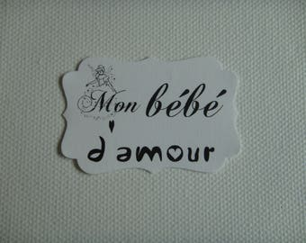 """Cut paper white personalized """"My baby love"""" tag black to create"""