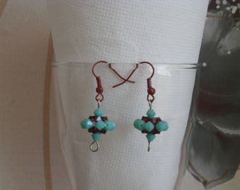 """Earrings """"Spinning"""" turquoise and dark fuchsia."""