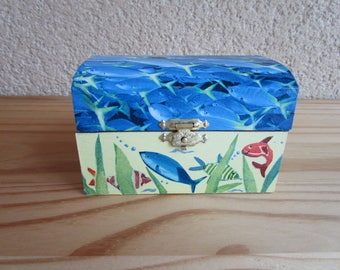 In a nice wooden box (sea animals) finger puppets.