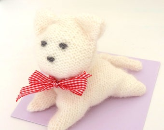 Toy, knitted white wool.