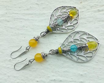 The Earrings: large leaf worked and decorated with beads