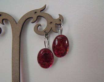 Pink spotted clear oval cabochon earrings