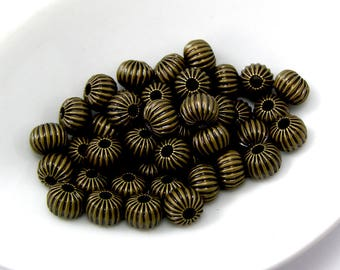 Round bronze separator beads 6 mm hole 1.5 mm set of 10