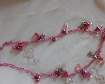 Boho necklace is pink, light