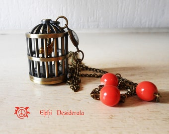 "Necklace shows ""birdhouse"" and abstract connector, romantic style"