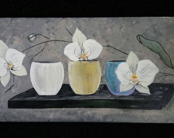 White orchids on a grey background