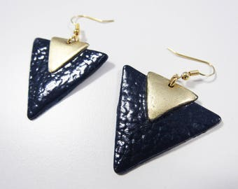 Earrings are made of Navy Blue and gold