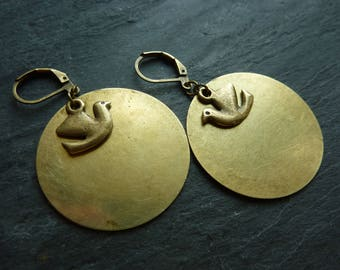 Large discs and bronze bird earrings