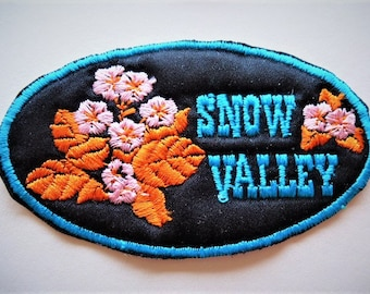 Snow valley, embroidered, patch applique blue, pink flowers on black 9 cm