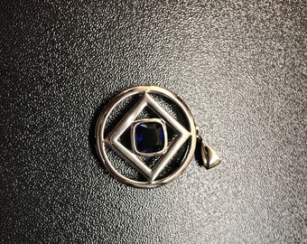 Sterling silver narcotics anonymous pendant that comes in blue, green, and red