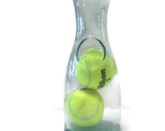 Tennis Balls in Glass Bottle - impossible object - impossible bottle - inspirational