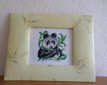 framed cross-stitch of a panda embroidery