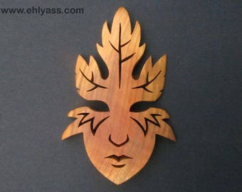 Fretwork autumn spirit mask sculpture