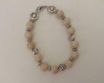 Silver metal Buddhas riverstone bracelet