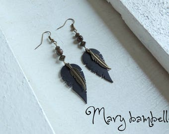 Earrings feather stone with recycled tractor inner