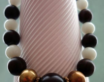 Ebony, opal glass and brass from Africa