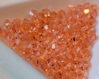 x 10 #T32 faceted bicone beads - pink saumonne - 4mm - Swarovski Crystal