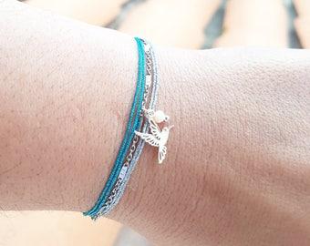 Chain, bird and glitter cord bracelet