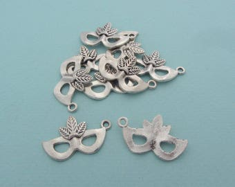 Set of 10 carnival masks charms (pendants) in silver metal