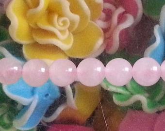 1 Pearl, rose quartz 6mm diameter, hole 1 mm